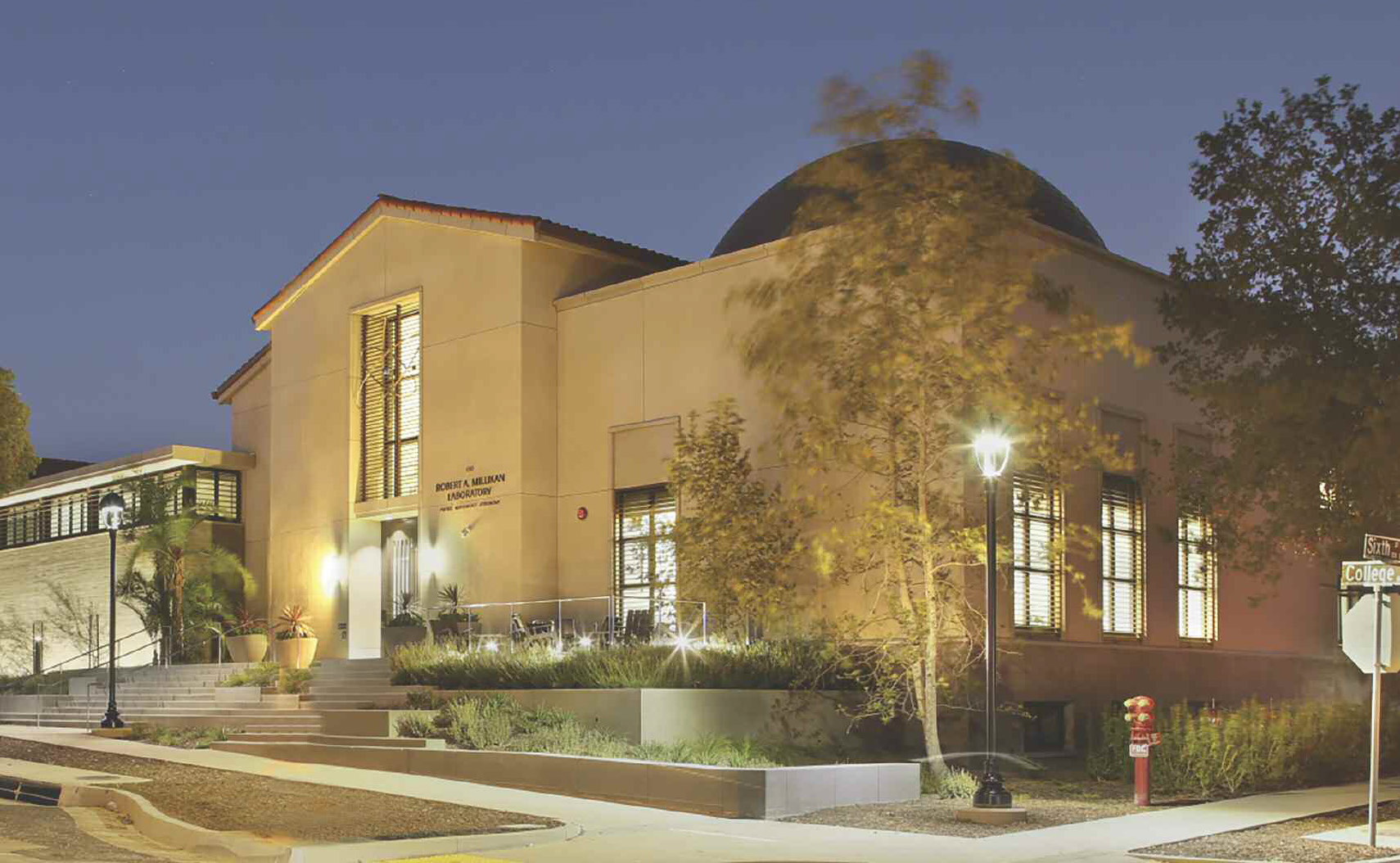 Millikan Laboratory lit up at night