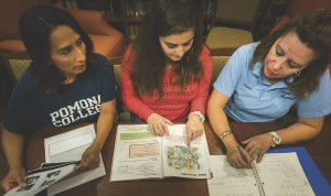 Student Ani Alyce Schug '17 works with housekeeping staff members Rosario Osorio and Beatriz Tovar on an English lesson