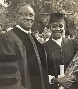 Esther Brimmer with her father, Andrew Brimmer, at the 1983 commencement exercises.