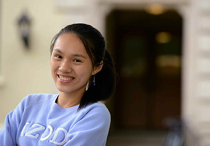 "Photo of Hong Deng Gao '15, with quote: ""I found so many mentors, professors and people coming from different back-grounds that are so willing to talk to you, and have compas-sion for issues they haven't really experienced before,"""