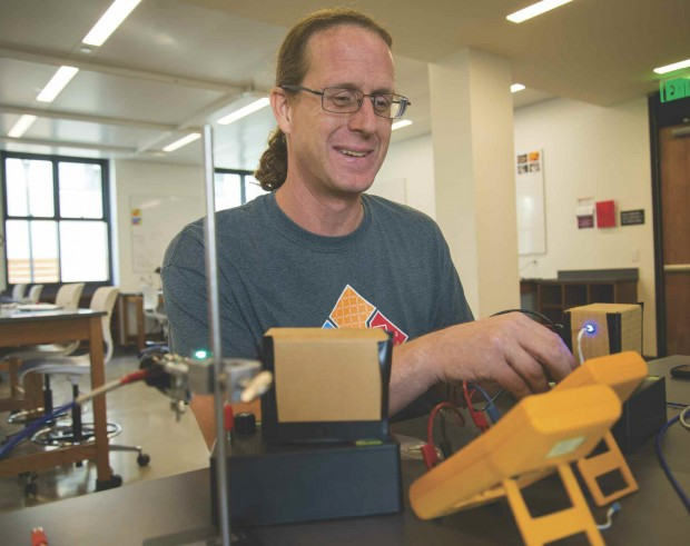 David Haley working with electronics
