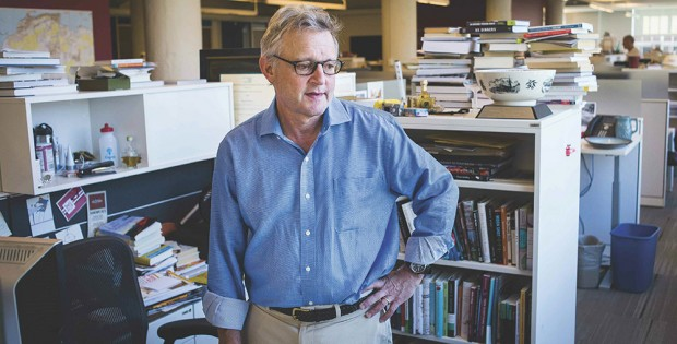 Joe Palca standing at his cubicle