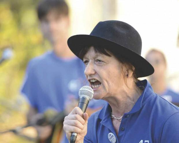 Professor Ami Radunskaya  singing into the microphone