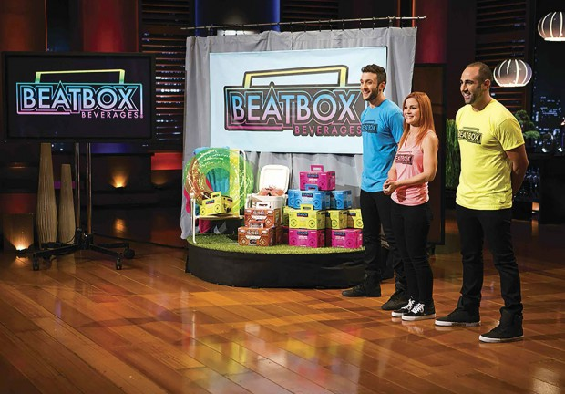 Justin Fenchel and his Beatbox partners on the stage on SharkTank