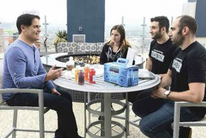 Justin Fenchel and his partners meeting at a table with Mark Cuban
