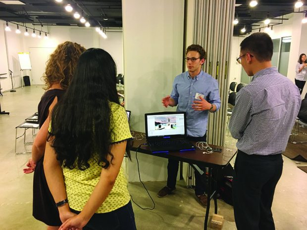 Avery Bedows '19 demos technology from his virtual reality startup Altar Technologies, Inc.