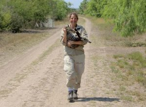 Swarts holds a sedated ocelot, who was then given a radio collar and released. (U.S. Fish and Wildlife Service photo)