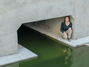 Swarts visits a wildlife underpass under construction. Though currently flooded, it will be dry when complete.