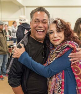 Rose Portillo '75 and co-star Daniel Valdez in a 1978 rehearsal of Zoot Suit and reunited in 2016 for the famous play's revival.
