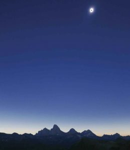 The eclipse reaches totality above the Grand Teton Mountains. Photo by Robert Gaines