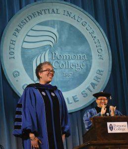 Chair of the Board Samuel D. Glick '04 applauds after the completion of Starr's official installation as Pomona's 10th president.