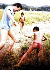 Gutkin playing with Yanomami children in the Amazon jungle