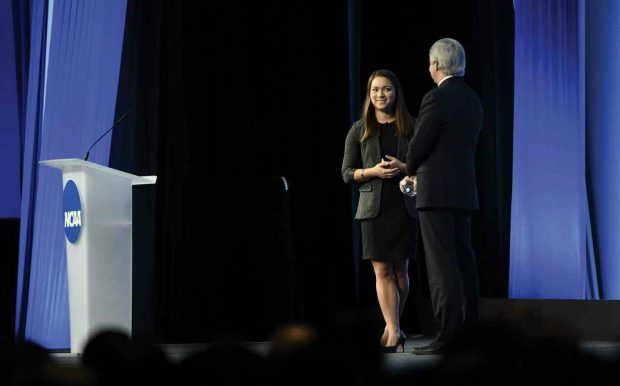 Alaina Woo '17 onstage with NCAA President Mark Emmert
