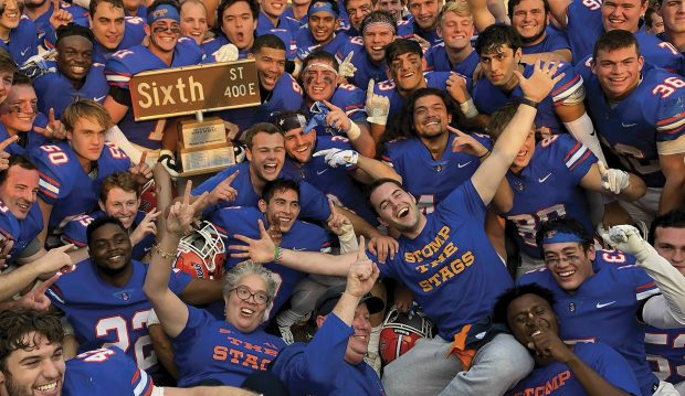 President G. Gabrielle Starr joins members of the Pomona-Pitzer football team to celebrate