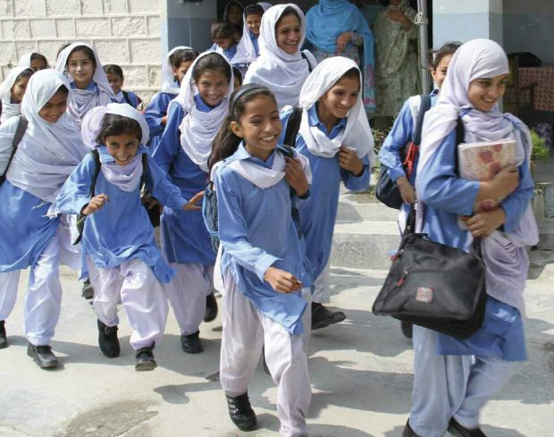 Pakistani children on their way to school.