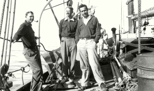 Revelle (right) aboard a research vessel with Harold Sverdrop (center), then director of Scripps Institution of Oceanography.