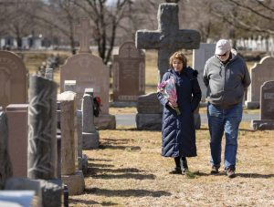 Ruth Craig '74 and Bob Sartini visit St. Michael Cemetery in Boston, where Spanish flu victim Adolfo Sartini is buried.