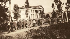 Soldiers parade in front of the Carnegie Building on Armistice Day, Nov. 11, 1918, wearing surgical masks to protect themselves from the Spanish flu.