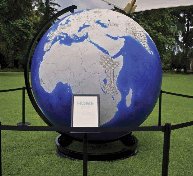 An 8-foot globe on display on Marston Quad, painted to show the various home countries of the new graduates