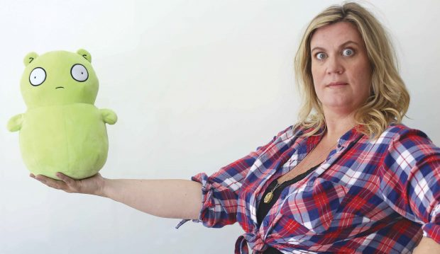 Wendy Molyneux holds a stuffed version of the mysterious Kuchi Kopi character from Bob's Burgers.