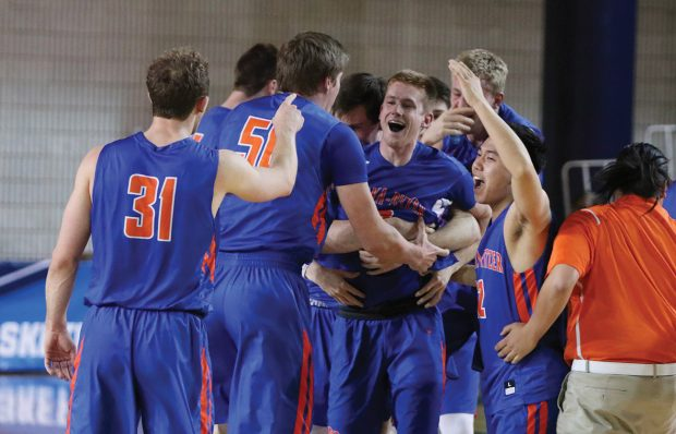 The team mobs Jack Boyle '20 after he hit the game-winning shot to send the Sagehens to the Sweet 16.
