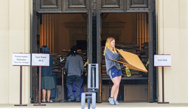 Pomona students pick up boxes and other packing supplies at Bridges Auditorium as they prepare to leave campus.