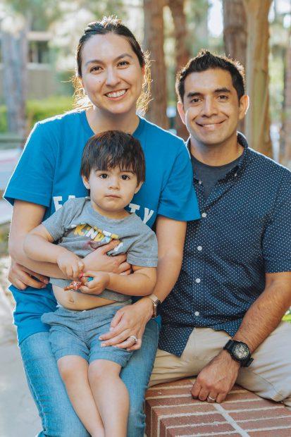 Genevieve Carpio '05, husband Eric Gonzalez and son Elliot. Their daughter was born in September.