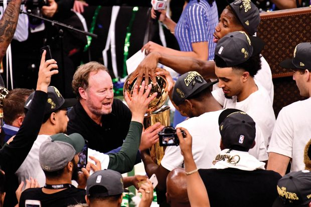Head Coach Mike Budenholzer '92 holds the Larry O'Brien Trophy after his Milwaukee Bucks win game six of the 2021 NBA Finals.