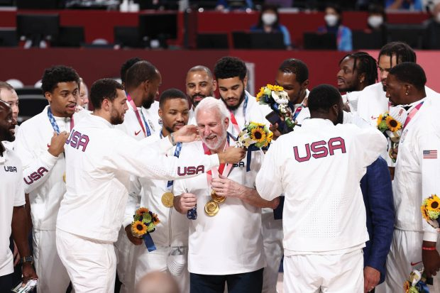 The USA Men's National Team present Head Coach Gregg Popovich with the gold medal after winning the Gold Medal Game of the 2020 Tokyo Olympics.